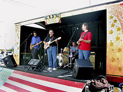 Image of Bob Christensen, Mark Dodge, Roger Ludwick, and Kevin Miller at the Stanwood-Camano Music Festival show, Sept. 7, 2002
