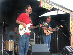Image of Bob Christensen, Mark Dodge, and Kevin Miller at the Stanwood-Camano Music Festival show, Sept. 7, 2002